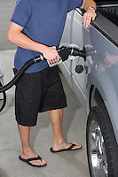 Young man with fuel pump