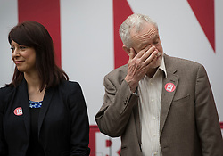 © Licensed to London News Pictures. 10/05/2016. London, UK. Labour party leader Jeremy Corbyn rubs his eye as he stands next to Gloria De Piero, Shadow Minister for Young People, as they launch the 'Labour In for Britain' campaign and a new EU referendum campaign bus. Photo credit: Peter Macdiarmid/LNP