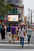 chinese people crossing road on green man in Shanghai China