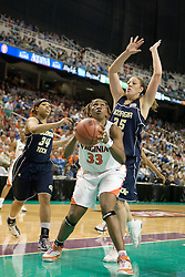 Virginia center Aisha Mohammed (33) prepares a shot while guarded by Georgia Tech forward Brigitte Ardossi (35).  The #4 seed/#25 ranked Virginia Cavaliers women's basketball team defated the #5 seed Georgia Tech Yellow Jackets 52-43 in the quarterfinals of the 2008 ACC Women's Basketball Tournament at the Greensboro Coliseum in Greensboro, NC on March 7, 2008.
