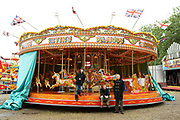 Teenagers Sitting On Fairground Ride