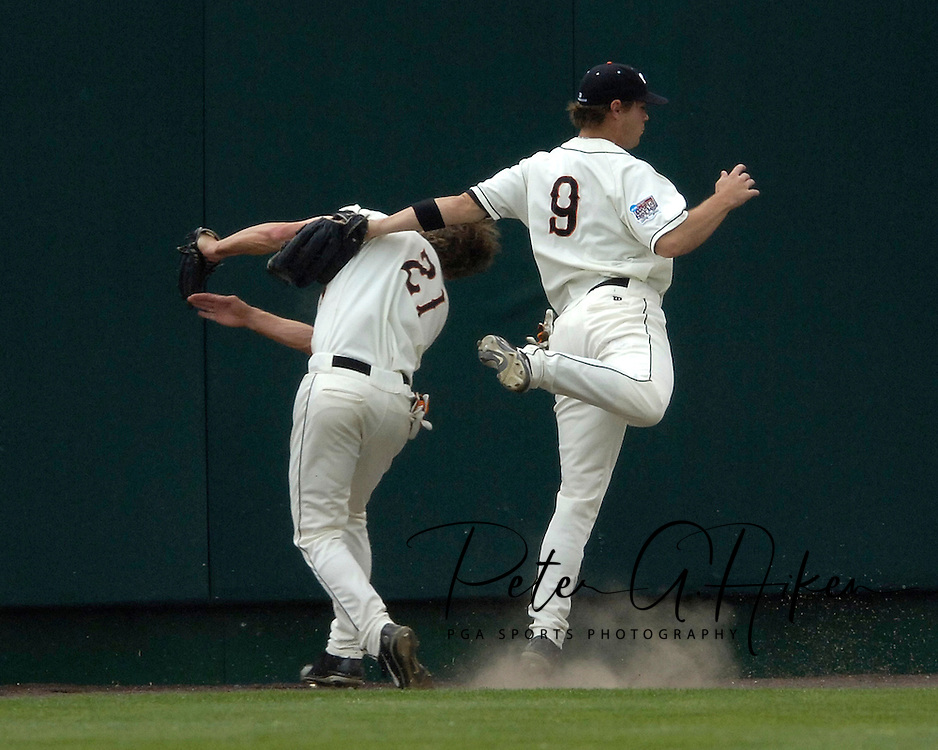 Oregon State center fielder Tyler Graham (21) makes the catch, as he collides with right fielder Ryan Gipson (14) in the bottom of the fourth inning against Miami,  during the College World Series at Rosenblatt Stadium in Omaha, Nebraska, June 17, 2006.