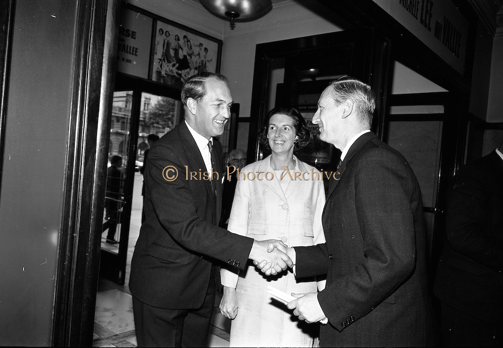 """24/07/1967<br /> 07/24/1967<br /> 24 July 1967<br /> First showing of """"Fleá Cheoil"""" at the Metropole Cinema, Dublin. A presentation was made to the director of the film Mr. Louis Marcus, for winning the Silver Bear Award at the Berlin International Film Festival, by Taoiseach Jack Lynch TD, on behalf of the Cork Film Society, where Mr. Marcus began his carrier. President of the Society Mr. Sean Hendrick attended the presentation. Image shows Minister for Industry and Commerce George Colley, TD and Mrs Mary Colley being greeted by Ribald Mac Gorain of Gael-Linn on arrival at the theatre."""