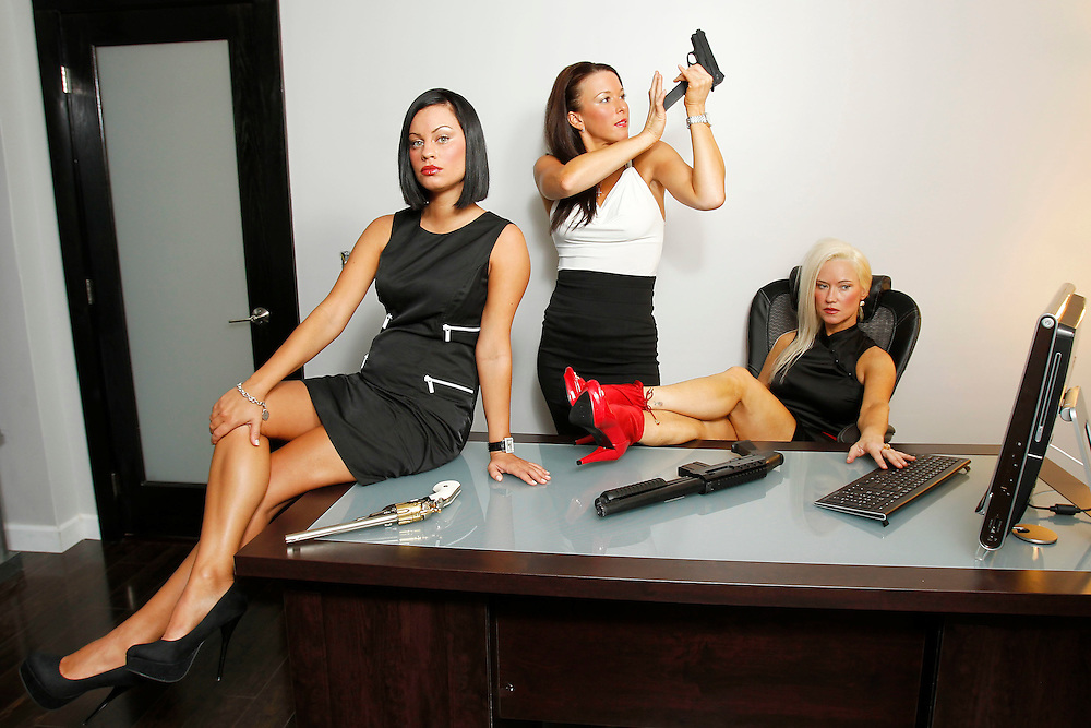 The real deal Charlie's Angels pose up in their Miami, Florida office on Friday, April 1, 2011. Charlie (blonde hair), Lauren (brown hair) and Caitlyn (black hair) are private investigators who work under the business name Charlie's Angeles P.I. Services, LLC. based in Miami. The company is female owned and operated with over 10 years of experience in the field. Also in the photos is Darren one of Charlie's male employees.