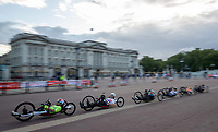 In-camera slow shutter speed pan used in this photo of Competitots race past Buckingham Palace in The Prudential RideLondon Handcycle Grand Prix. Saturday 28th July 2018<br /> <br /> Photo: Jed Leicester for Prudential RideLondon<br /> <br /> Prudential RideLondon is the world's greatest festival of cycling, involving 100,000+ cyclists - from Olympic champions to a free family fun ride - riding in events over closed roads in London and Surrey over the weekend of 28th and 29th July 2018<br /> <br /> See www.PrudentialRideLondon.co.uk for more.<br /> <br /> For further information: media@londonmarathonevents.co.uk