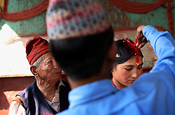 Village leader Pudke Shreshta Balami leads the young couple Bishal Shreshta Balami, 15, and Surita Shreshta Balami, 16, in the wedding ceremony Kagati Village, Kathmandu Valley, Nepal on Jan. 24 ,2007. Here, Bishal puts vermillion on Niruta's head, officially signifying their union. Early marriage is a harmful traditional practice common in Nepal. The Kagati village, a Newar community, is most well known for its propensity towards this practice. Many Hindu families believe blessings will come upon them if marry off their girls before their first menstruation.
