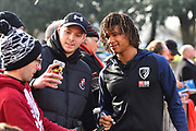 Nathan Ake (5) of AFC Bournemouth having a selfie with a fan on arrival at the Vitality Stadium before the Premier League match between Bournemouth and Arsenal at the Vitality Stadium, Bournemouth, England on 25 November 2018.