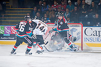 KELOWNA, CANADA - OCTOBER 22: Brady Brassart #14 of the Calgary Hitmen tries to get the puck past Mitchell Wheaton #6 of the Kelowna Rockets on October 22, 2013 at Prospera Place in Kelowna, British Columbia, Canada.   (Photo by Marissa Baecker/Shoot the Breeze)  ***  Local Caption  ***