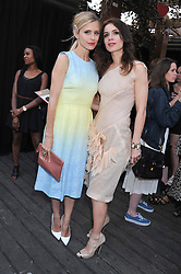 Left to right, LAURA BAILEY and LARA BOHINC at Tunnel of Love - a fashion & art party in aid of The British Heart Foundation held at The Proud Gallery, Camden, London on 29th May 2012.