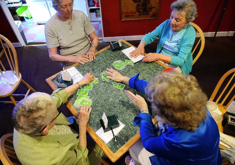 7/5/16 :: REGION :: BALDELLI :: The Faire Harbor Bridge Club, from left, Betty Wolff, Gail Bogucki, Louise Clemens and Roseanne Strazzo reach for their cards during their weekly game Tuesday, July 5, 2016 at The Lyme Tavern in Niantic. The club has been playing for over 100-years. (Sean D. Elliot/The Day)
