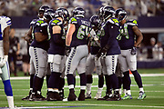The Seattle Seahawks offense huddles and calls a play during the NFL football NFC wild card playoff game against the Dallas Cowboys on Saturday, Jan. 5, 2019 in Arlington, Tex. The Cowboys won the game 24-22. (©Paul Anthony Spinelli)
