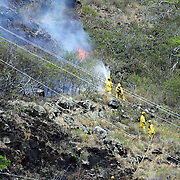 HFD firefighters battle to contain a Hawaii Kai, Oahu brushfire before it crosses over the ridge from Pepeekeo St. to Kawaihae Dr and the condos below.  Photo by Barry Markowitz, 9/4/13, 11:45am