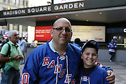 May 13, 2015 - New York, NY. Father and son, Avi and Yoel Rosman, share a father-son moment prior to entering game 7 against the Washington Capitals, at Madison Square Garden. Photograph by Anthony Kane/NYCity Photo Wire