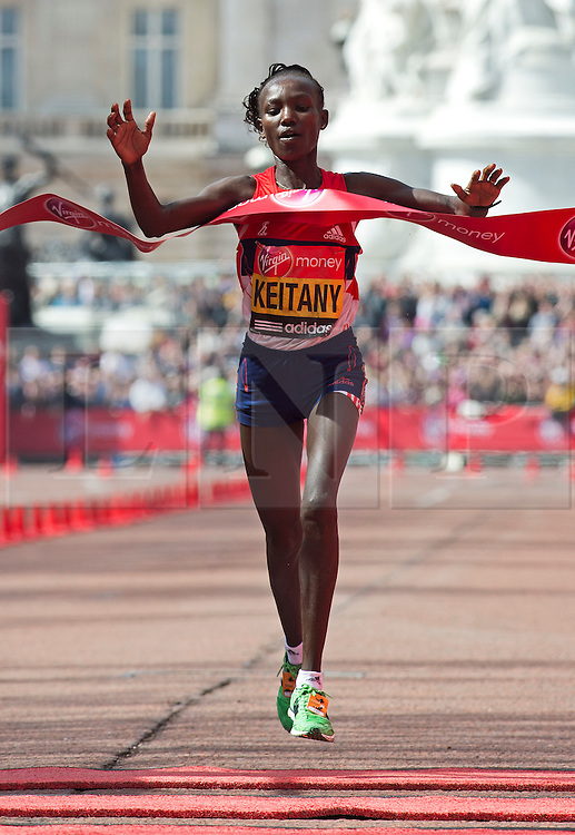 © London News Pictures. 22/04/2012. London, UK. Mary Keitany of Kenya crosses the finish line to win the women's elite race during the 2012 Virgin London Marathon on April 22, 2012. Photo credit : Ben Cawthra /LNP