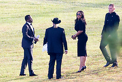 Music mogul Diddy holds hands with singer Mary J Blige as they arrive at the memorial gardens where former girlfriend Kim Porter, the mother of three of his children, will be laid to rest. Among the mourners were Kim's children and her grandmother. Mourners arrived at Evergreen Memorial Park After the funeral service at Cascades Hills Church in the former model's hometown of Columbus, Georgia. Diddy overcame his grief to deliver a moving eulogy. Others who gave eulogies included Blige, Dallas Austin, Bishop Noel Jones and Porter's son, actor and singer Quincy Brown. Quincy broke down as he spoke and was joined at the mic by his father, Al B. Sure!, and Diddy. The service was packed with celebrities including best friend Kimora Lee Simmons, Missy Elliot, Lil Kim, Tichina Arnold, NeNe Leakes, Fat Joe, Kandi Burress, Winnie Harlow, Ryan Destiny, Stevie J and more. Porter died after suffering from a bout of pneumonia but her exact cause of death is unknown. She was just 47. Diddy, 49, and Porter were together, off and on, for 10 years, and although they were no longer a couple, they were still close, sharing three children: son Christian, 20, and twin daughters D'Lila Star and Jessie James, who turn 12 next month. They also raised 27-year-old Quincy Brown, Porter's son with singer and record producer Al B. Porter died at her Los Angeles home on Nov. 15. An autopsy was performed the next day but the results were deferred for further testing, which could take weeks. 24 Nov 2018 Pictured: P Diddy, Sean Combs, Mary J Blige, Others,. Photo credit: MEGA TheMegaAgency.com +1 888 505 6342