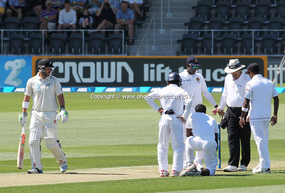 Shaminda Eranga of Sri Lanka crouching at the bowling crease after falling while bowling the first ball of his first over on Day 1 of the boxing Day Cricket Test Match  the Black Caps v Sri Lanka at Hagley Oval, Christchurch. 26 December 2014 Photo: Joseph Johnson / www.photosport.co.nz