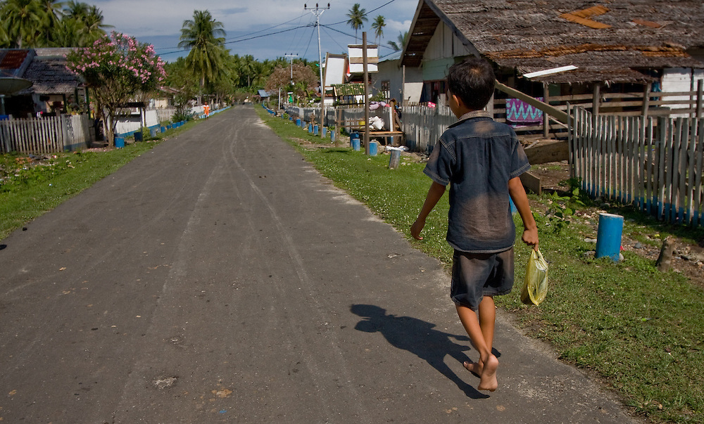 A boy carries his shopping home in Teku, Central Sulawesi