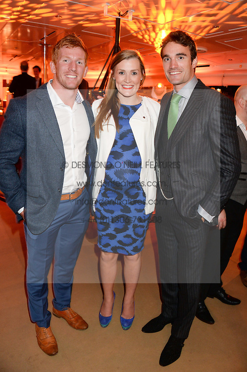 Johnnie Walker Gold Label Reserve Finale Celebration Party aboard the John Walker & Sons Voyager moored at the Prince of Wales Docks, Leith, Edinburgh, Scotland on 14th August 2013.<br /> Picture shows:-Left to right, Roddy Grant, his wife Emma Grant and Thom Evans.
