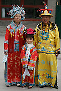 Qiongdao (Jade Island) in Beihai Lake. One-child-family posing in traditional Chinese clothes.