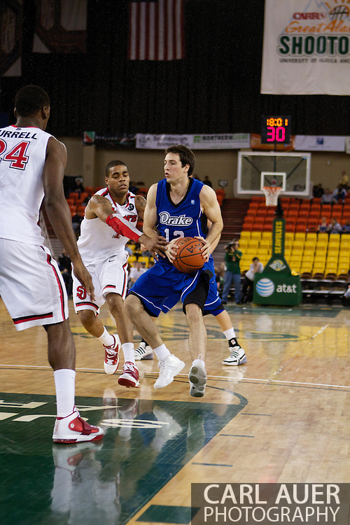 November 26th, 2010:  Anchorage, Alaska - Drake Bulldog junior guard Frank Wiseler (13) drives to the lane in the Bulldog's loss to St. Johns at the Great Alaska Shootout.  The Red Storm defense held Drake to a tournament low score as St. Johns advanced to the final game 82-39.