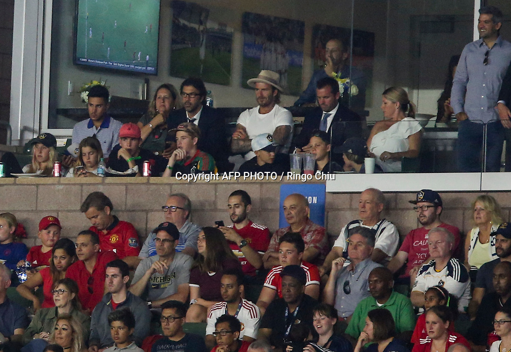 David Beckham, top center,  watches Los Angeles Galaxy play against Manchester United during the second half of a national friendly soccer game at StubHub Center on July 15, 2017 in Carson, California. Manchester United won 5-2. AFP PHOTO / Ringo Chiu