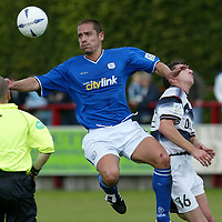 Brechin v St Johnstone....Pre-season friendly..17.07.04<br />Ref Terry Brunton close to the action as Paul Bernard beats Craig Winter to the ball<br /><br />Picture by Graeme Hart.<br />Copyright Perthshire Picture Agency<br />Tel: 01738 623350  Mobile: 07990 594431
