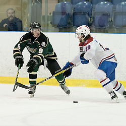 KINGSTON, ON - MAR 9,  2017: Ontario Junior Hockey League, playoff game between the Cobourg Cougars and Kingston Voyageurs,Connor MacEachern #9 of the Cobourg Cougars battles for the puck with Reed Kekewich #20 of the Kingston Voyageurs during the 2nd period.<br /> (Photo by Ian Dixon/ OJHL Images)