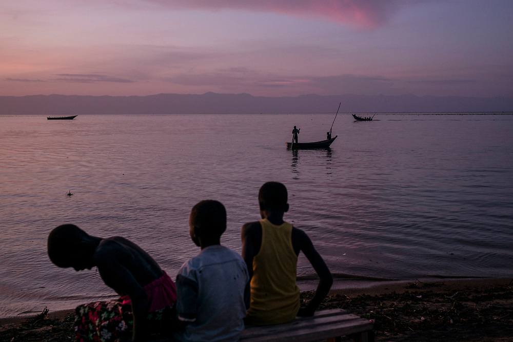 SEBAGORO, UGANDA - MARCH 22: Boats off the shore in Sebagoro, one of the main landing sites for refugees fleeing across Lake Albert, in Sebagoro, Uganda on March 22, 2018. Violence in Ituri Province in northeastern Democratic Republic of Congo has displaced more than 100,000 people including approximately 40,000 refugees who have fled to Uganda. (Photo by Andrew Renneisen for The Washington Post)