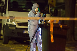 Police have erected a cordon closing of a wide area surrounding the scene in Chestnut Avenue, Forest Gate, East London where an 18 year-old male was stabbed to death at around 11pm on Monday night. London, April 17 2018.