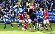 Luke Steele (1) of Barnsley punches clear under pressure from a Reading corner during the Npower Championship match between Reading and Barnsley on Saturday 25th September 2010 at the Madejski Stadium, Reading, UK. (Photo by Andrew Tobin/Focus Images)