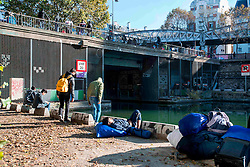 October 31, 2016 - Paris, France - some migrants are waiting for the evacuation to calm down in Paris, France on 31 October 2016. More migrants and refugees coming from the dismantling of Calais and also from Italy are living in the streets of Paris, between the Stalingrad and Jaures tube Stations, in the north of the French capital. The police evacuates one of the camp, with migrants from Afgahnistan and Pakistan. (Credit Image: © Guillaume Pinon/NurPhoto via ZUMA Press)