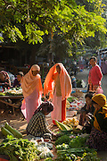 Nuns shopping for food at Mandalay market, Burma
