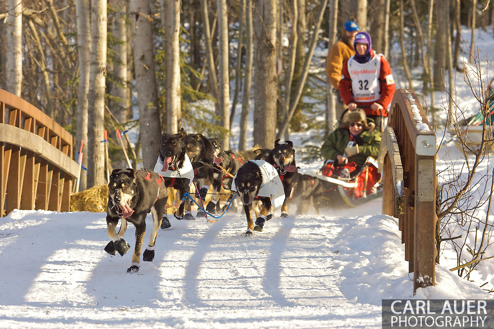 March 7th, 2009:  Anchorage, Alaska - Alan Peck of Eagle River, Alaska brings his team across a foot bridge near Behm Lake during the 2009 Ceremonial Start to the Iditarod Sled Dog Race.