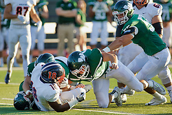 {BLOOMINGTON, IL: Jaelin Goldsmith gang tackled by 4 Titans during a college football game between the IWU Titans  and the Wheaton Thunder on September 15 2018 at Wilder Field in Tucci Stadium in Bloomington, IL. (Photo by Alan Look)