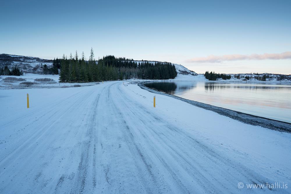 Ice covered road at the lake Thingvallavatn, Iceland - Ísilagður vegur við Þingvallavatn