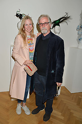 ITHAKA RODDAM and her father FRANC RODDAM at a private view and auction of millinery organised by author, philanthropist and hat collector Eva Lanska in aid of Women for Women International held at Pace, Burlington Gardens, London on 10th June 2015.