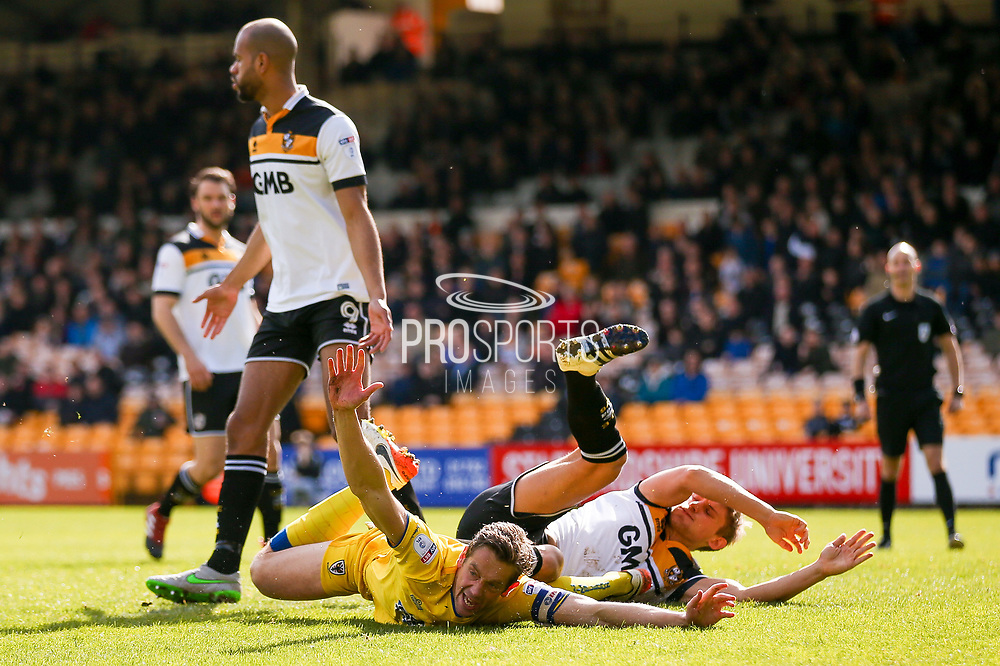AFC Wimbledon defender Paul Robinson (6) goes down under a challenge and appeals for a penalty during the EFL Sky Bet League 1 match between Port Vale and AFC Wimbledon at Vale Park, Burslem, England on 1 April 2017. Photo by Simon Davies.
