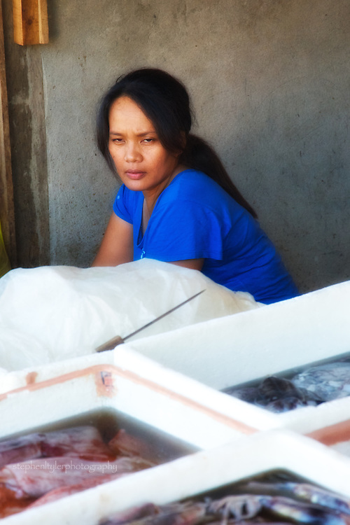 A fish vendor in wet market in the coastal town of Real, in the Quezon Province on the Pacific side of the Philippines