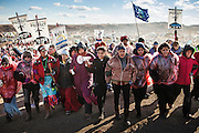 Native American women lead a march to Backwater Bridge, where armed security and local law enforcement defend ongoing construction of the Dakota Access Pipeline, a much-assailed oil infrastructure project that would threaten the drinking water of 17 million Americans if allowed to be built beneath the Missouri River, as planned, just north of the Standing Rock Sioux Reservation in North Dakota.
