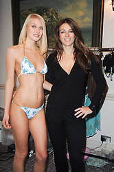 Model and ELIZABETH HURLEY at a shopping afternoon hosted by Amanda Kyme and Tamara Beckwith featuring designs from Elizabeth Hurley held at the Cadogan Hotel, 75 Sloane Street, London SW1 on 23rd November 2010.