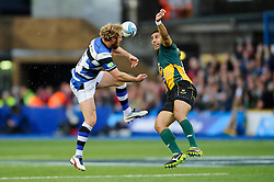 Bath Full Back Nick Abendanon and Northampton Winger Ken Pisi compete in the air for a high ball - mandatory by-line: Rogan Thomson/JMP - Tel: 07966 386802 - 23/05/2014 - SPORT - RUGBY UNION - Cardiff Arms Park, Wales - Bath Rugby v Northampton Saints - Amlin Challenge Cup Final.
