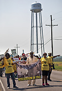 "Marchers in St. James Louisaina  heading toward the site of a proposed Formosa chemical plant on the third day of a five day march through Louisiana's 'Cancer Alley' held by the Coalition Against Death Alley. The Coalition Against Death Alley (CADA), is a group of Louisiana-based residents and members of various local and state organizations, is calling for a stop to the construction of new petrochemical plants and the passing of stricter regulations on existing industry in the area that include the groups RISE St. James, Justice and Beyond, the Louisiana Bucket Brigade, 350 New Orleans, and the Concerned Citizens of St. John  Louisiana's Cancer Alley, an 80-mile stretch along the Mississippi River, is also known as the ""Petrochemical Corridor,"" where there are over 100 petrochemical plants and refineries"