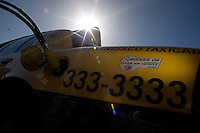 SAN FRANCISCO, CA - OCT 25:   Yellow Taxi company employees fill their taxis with natural gas before their shift on October 25, 2010 in San Francisco, California. San Francisco was recently rated the second greenest US city overall, narrowly beaten by Portland Oregon. Photography by David Paul Morris