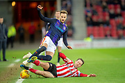 Aiden McGeady (#19) of Sunderland AFC slide tackles Andrew Shinnie (#11) of Luton Town FC during the EFL Sky Bet League 1 match between Sunderland AFC and Luton Town at the Stadium Of Light, Sunderland, England on 12 January 2019.