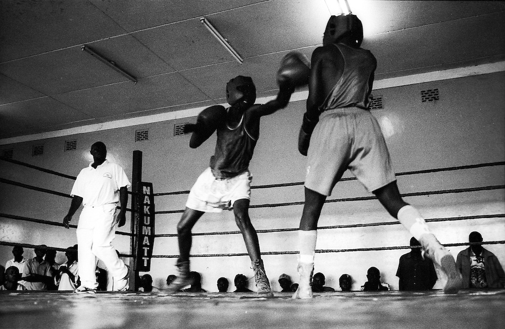 NAIROBI, KENYA - MARCH 18, 2010: Young athletes compete in a boxing tournament featuring the Kibera Olympic Boxing Club, Kenya Prisons and the Kenya Police and Armed Forces (AFABA). Each year, Kibera Olympic boxers aspire individually to make the national team, and the opportunity to compete in the annual Kenya Open boxing tournament. In previous years, boxers from Kibera slum have gone on to win tournaments on both the national and international stage.<br /> <br /> Within Kenya's progressive youth culture is the Kibera Olympic Boxing Club, a group of low-income adolescents from the slum whose leader uses boxing as a way to engage with idle youth. The group's ethnic diversity is remarkable given Kenya's 2008 post-election violence in which people from several tribes were forced violently out of slums. Together, these boxers represent a nascent trend of cross-tribe brotherhood in a healing nation.