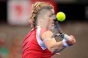 Brisbane, Australia, January 1: Kim Clijsters of Belgium plays a forehand shot during her match against Simona Halep of Romania at Pat Rafter Arena on day one of the 2012 Brisbane International Tennis Tournament in Brisbane, Australia on Sunday January 1st, 2012. (Photo: Matt Roberts/Photo News)