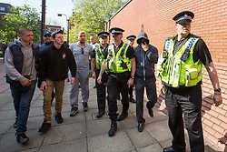 © Licensed to London News Pictures. 11/05/2017. Leeds UK. There are Angry scenes outside Leeds Crown Court this morning as members of the English Defence League confront men wearing Balaclavas arriving at court. 29 men & women are due to appear today at Leeds Crown Court over charges of Rape, Neglect & Sex abuse on girls as young as 11 years old. Twenty-seven men have been charged, with one man alone charged with 21 offences of rape. West Yorkshire Police say the men face numerous offences including rape, trafficking with intent to engage in sexual exploitation, sexual activity with a child, child neglect, child abduction, supply of Class A drugs and possession and making of indecent images of children. Photo credit: Andrew McCaren/LNP