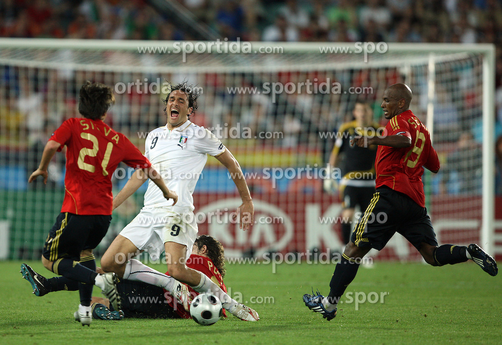 Luca Toni of Italy (9) and Carles Puyol of Spain (5) lying during the UEFA EURO 2008 Quarter-Final soccer match between Spain and Italy at Ernst-Happel Stadium, on June 22,2008, in Wien, Austria. Spain won after penalty shots 4:2. (Photo by Vid Ponikvar / Sportal Images)