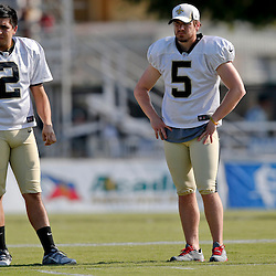 Jul 29, 2013; Metairie, LA, USA; New Orleans Saints kickers  Jose Carlos Maltos (2) and Garrett Hartley (5) during a morning training camp practice at the team facility.  Mandatory Credit: Derick E. Hingle-USA TODAY Sports