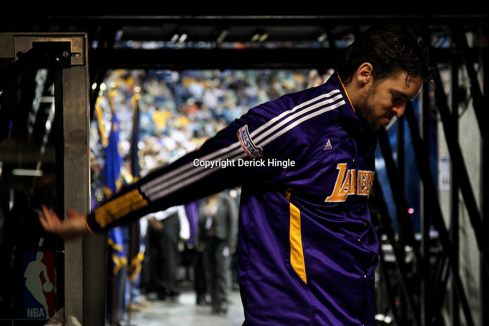 April 24, 2011; New Orleans, LA, USA; Los Angeles Lakers power forward Pau Gasol (16) stretches in the tunnel before tip off of game four of the first round of the 2011 NBA playoffs against the New Orleans Hornets at the New Orleans Arena.    Mandatory Credit: Derick E. Hingle
